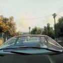 Niko drives a black car through a residential area. | Views: 4313