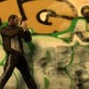 Niko walks along a grafitti covered wall, gun drawn. | Views: 2219