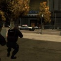 The SWAT team moves in to secure the area in front of the bank. | Views: 1316