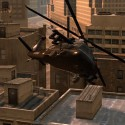 A helicopter hovers over the rooftops. | Views: 2502