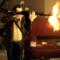 Niko fires an AK-47 from the cover of some parked cars. | Views: 1540