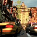 A taxi and police car travel through China Town. | Views: 54271