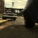 Niko tails a police car over a curb.   Views: 2459