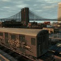 A train heads around the tracks towards the big city. | Views: 2278