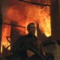 Niko walks past a burning building | Views: 2058