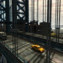A few vehicles drive across a large bridge. | Views: 2169