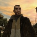 The main character Niko Bellic stands in a park. | Views: 2008