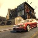 A red car drives down a short hill. | Views: 3592